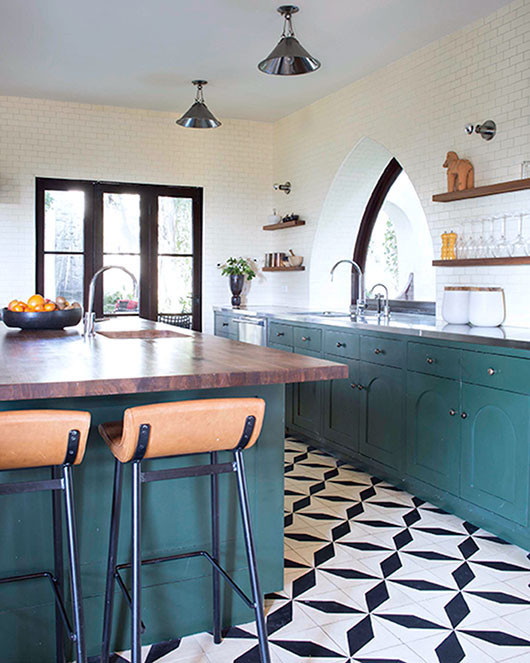 green cabinets and black and white kitchen floors