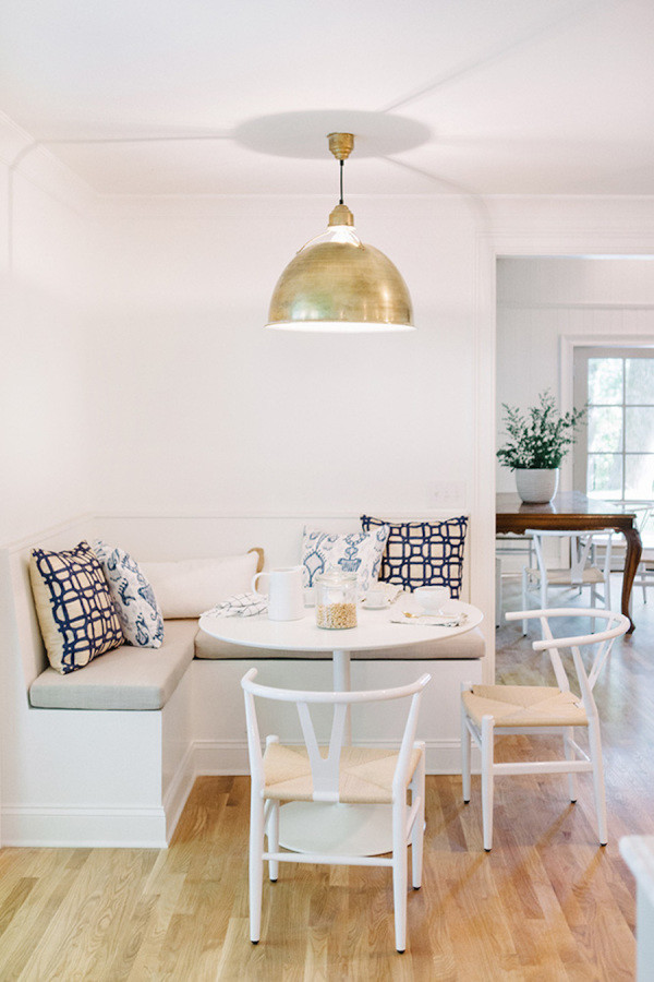 Gold pendant white breakfast nook