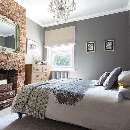 exposed brick wall gray bedroom