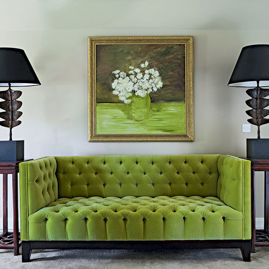 green tufted sofa