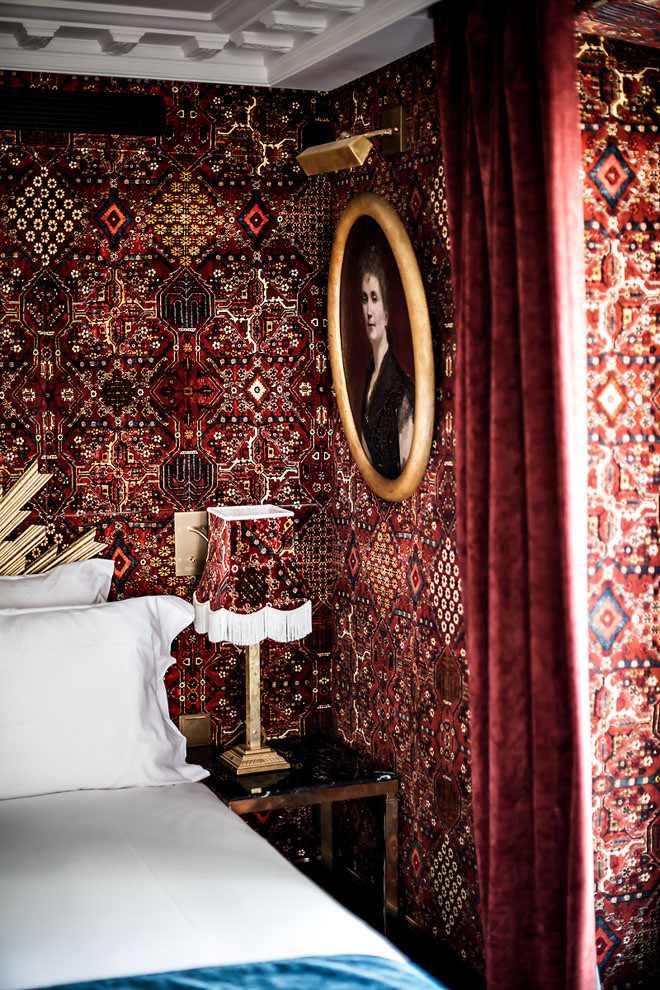 red tapestry Paris France hotel wallpaper