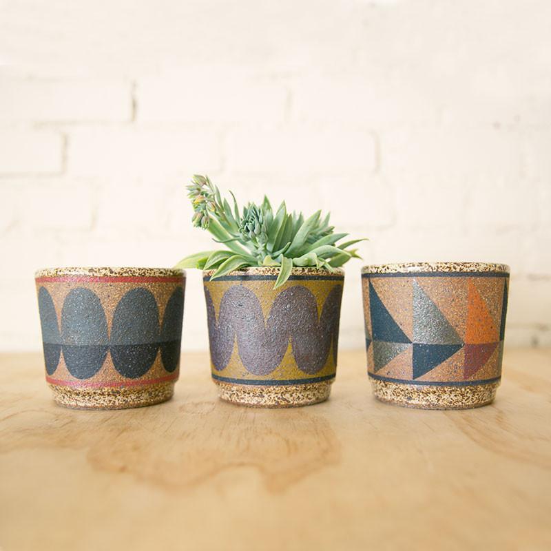 geometrically painted planters