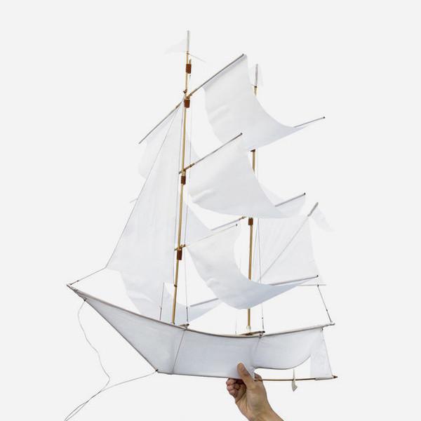 white sailing ship kite