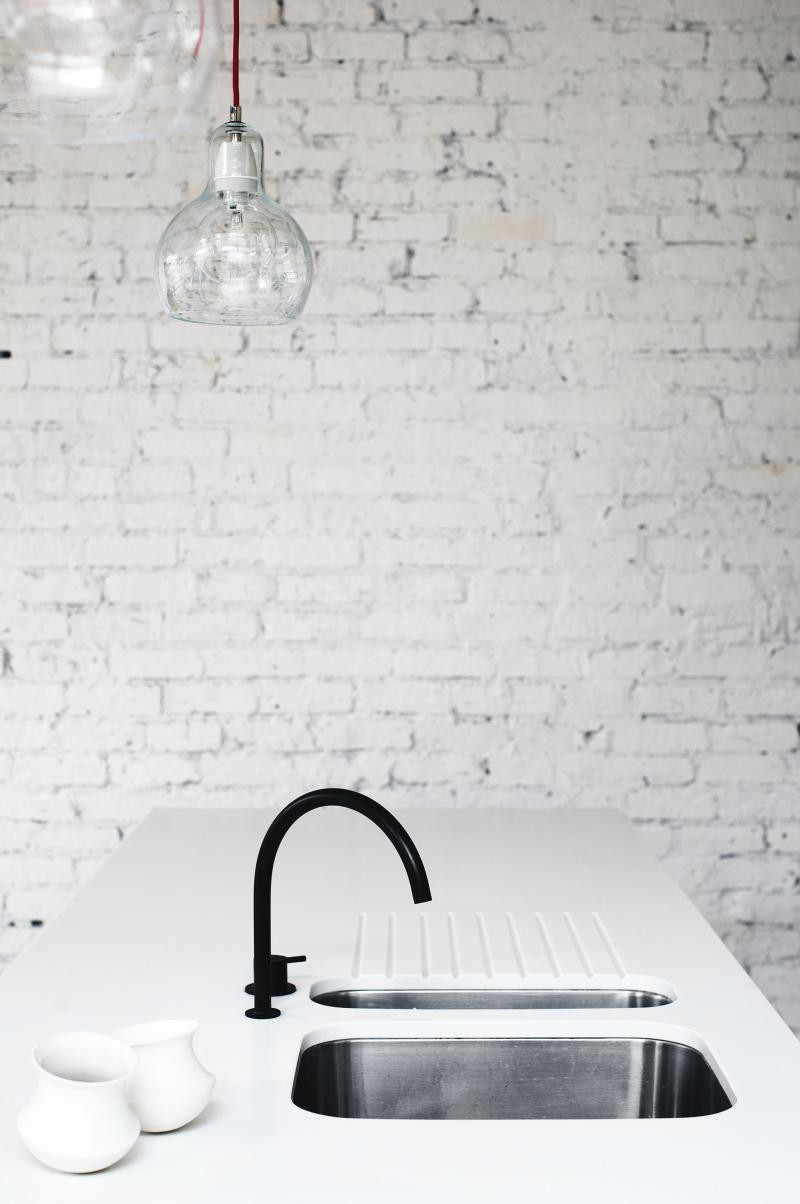black faucet minimal kitchen