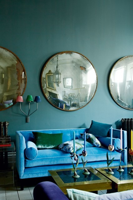 blue velvet sofa convex mirror