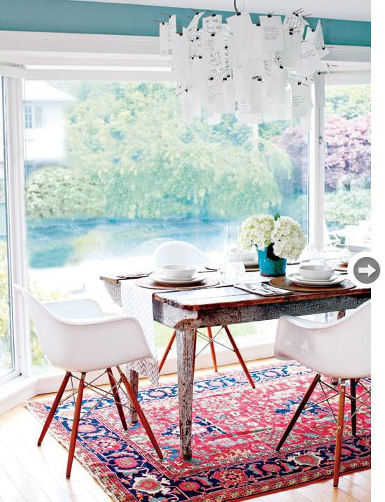 white eames chair antique carpet