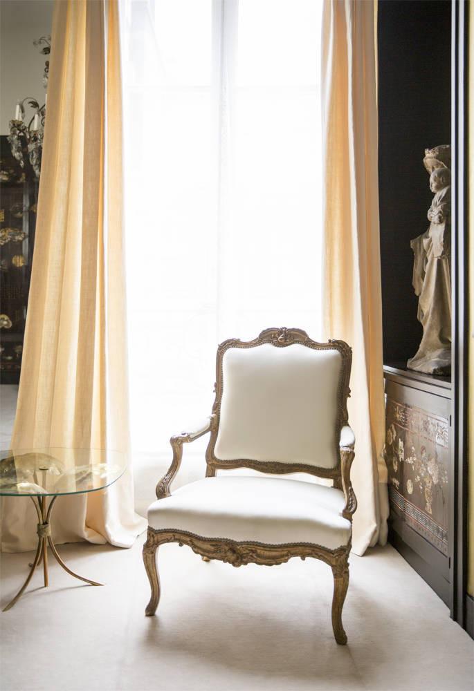 white linen curtain bergere chair