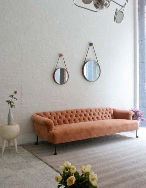 pink tufted sofa