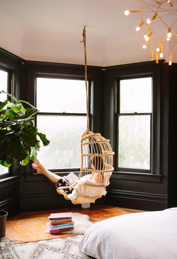 hanging chair black walls