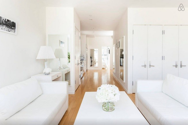 all white penthouse living room