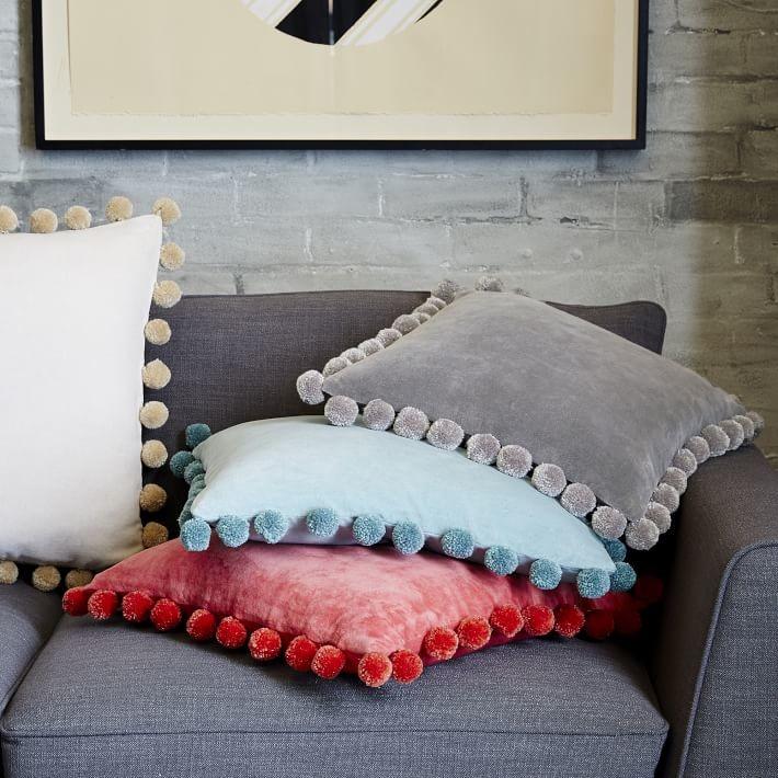 Velvet pillows with pompoms