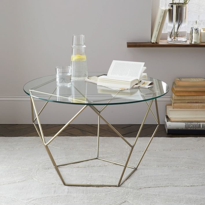 geometric coffee table made of origami metal and glass