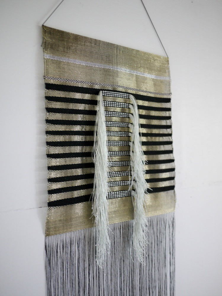 Textile wall hanging with fringes