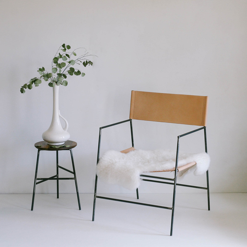 minimal armchair made of leather and steel