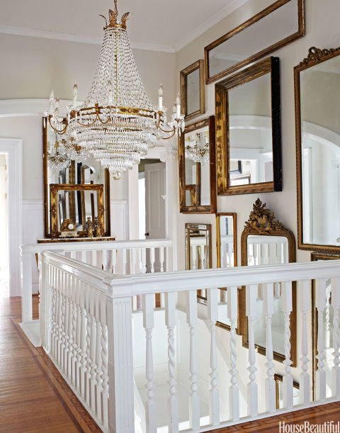 Gilded mirror gallery wall crystal chandelier