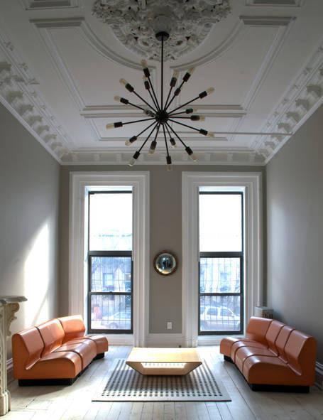 stylish brownstone living room apartment rental