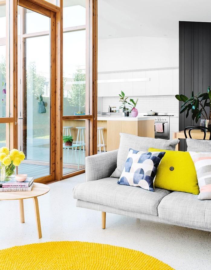 yellow and blue throw pillow gray sofa