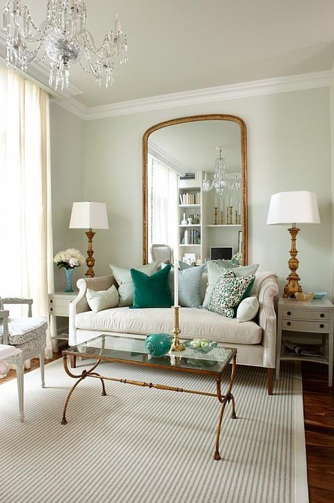 neutral living room design of green pillows