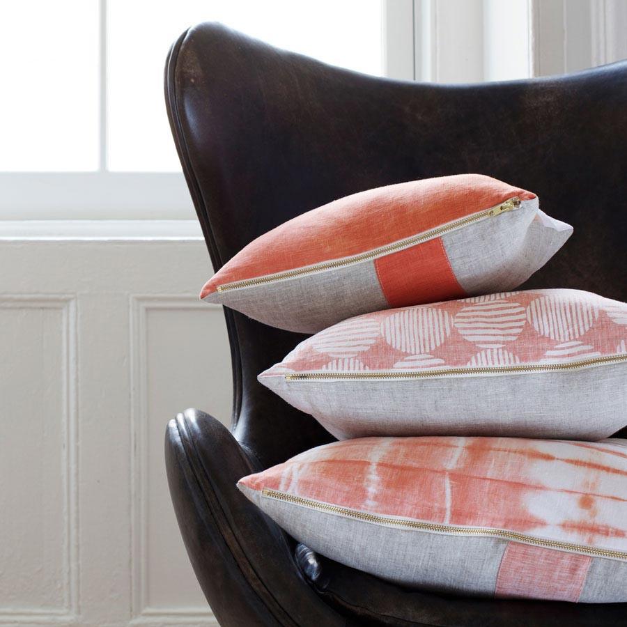 Coral Shibori cushion black chair