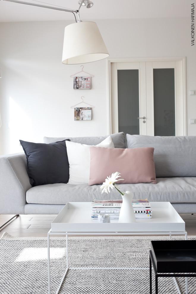 light pink and blue pillows gray sofa