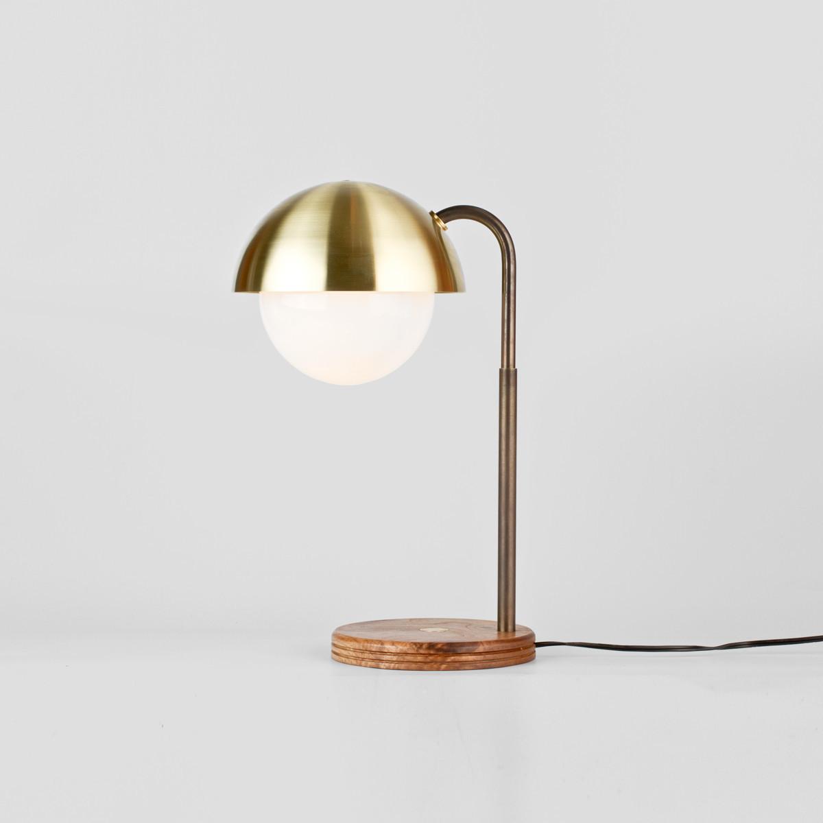round desk lamp made of brass