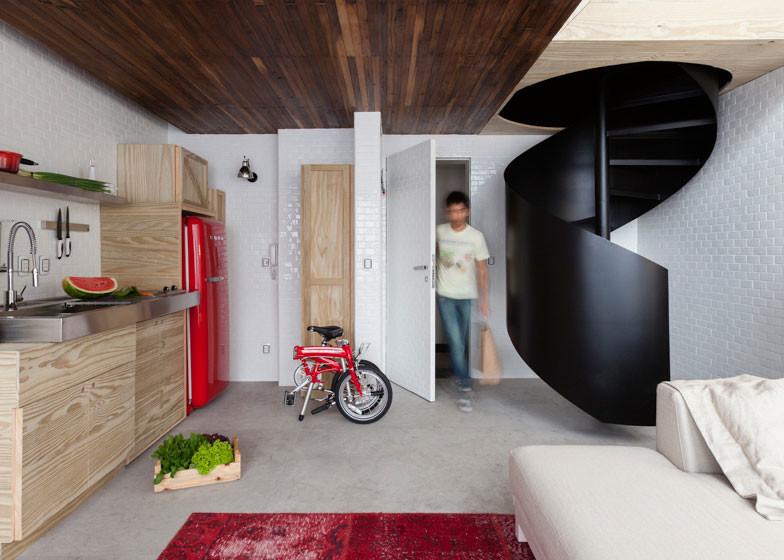 round black stairs micro-apartment