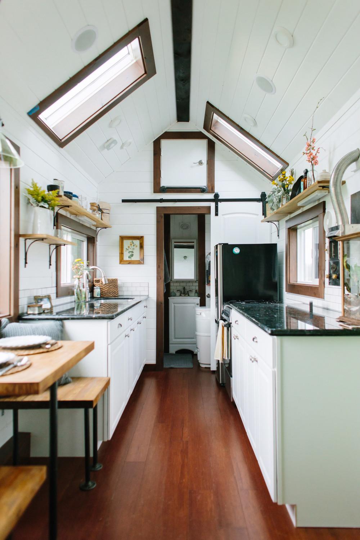 white micro home kitchen skylights