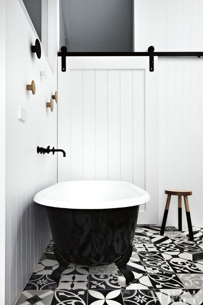 Black and white bathroom of the lacquer tub