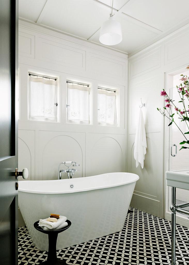 Black and white encaustic tile master bathroom
