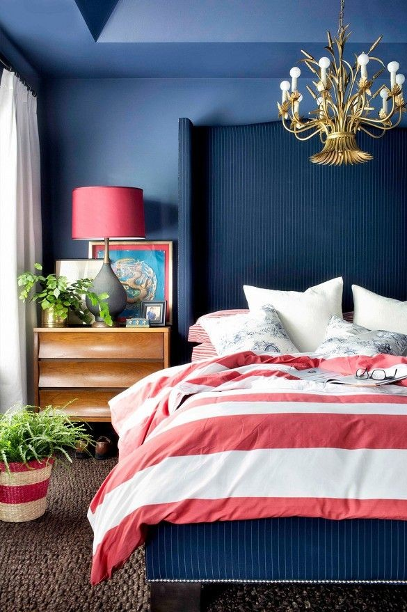 Eclectic blue bedroom with red accents