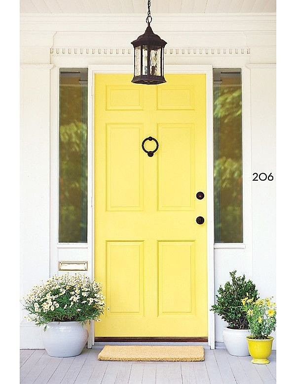 Yellow front door with modernist house numbers