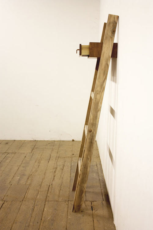 crooked wooden ladder with drawer