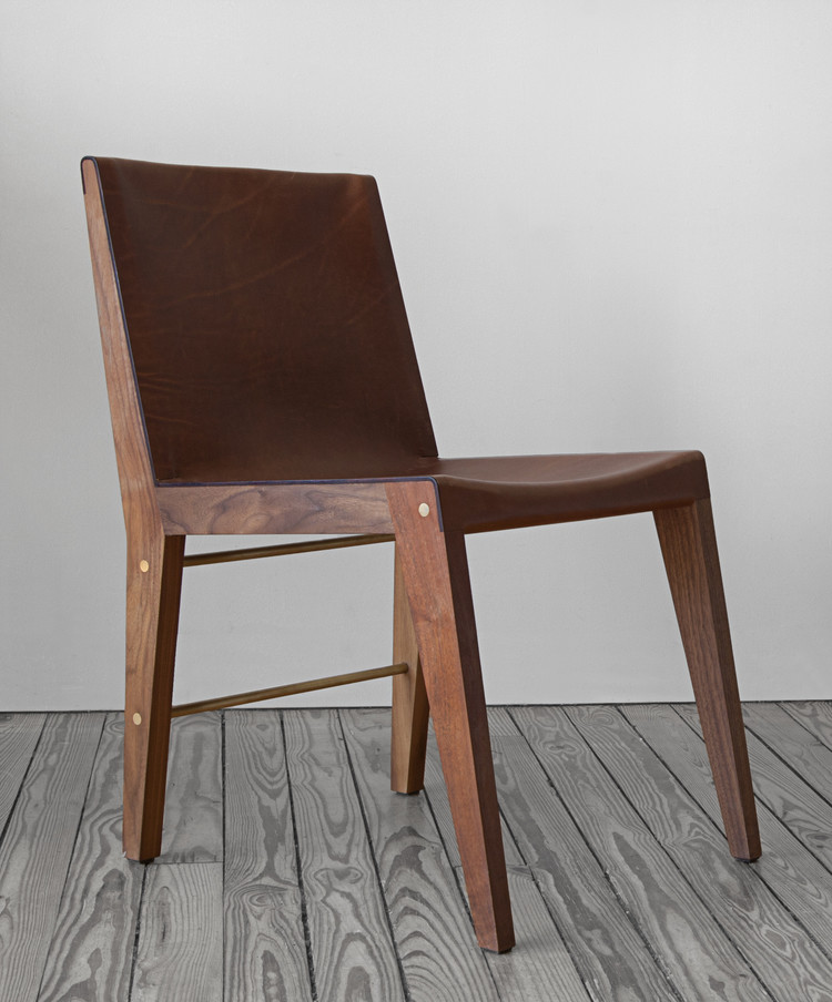 Wooden chair with brass bolts