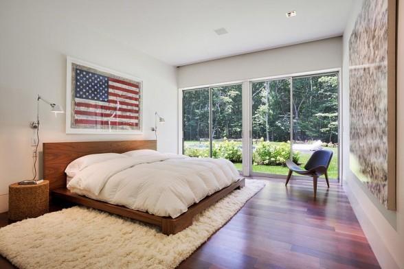 framed flag art over the bed
