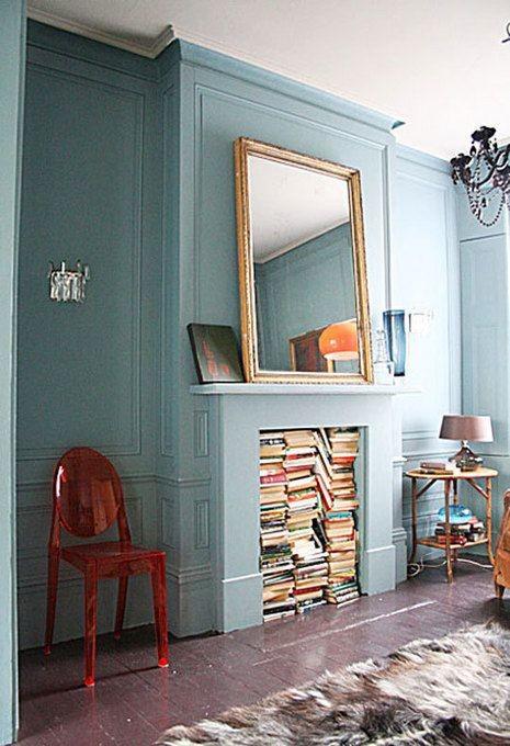 Books in fireplace storage idea