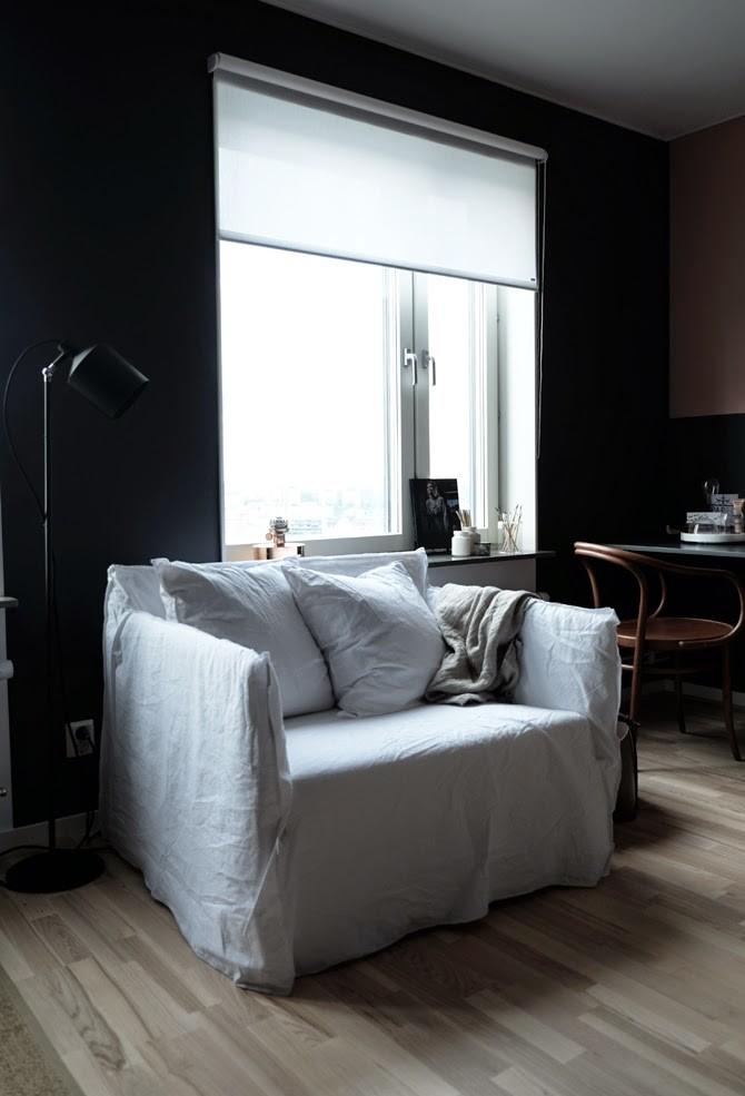 white slipcover armchair black walls