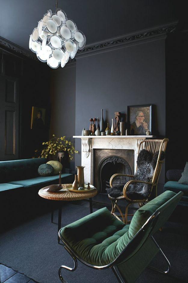 black walls green sofa living room