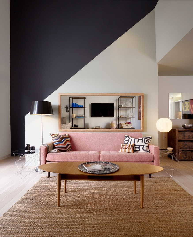 light pink sofa black and white living room wall