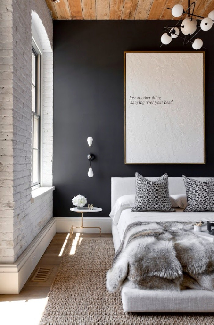 white brick and black accent wall in bedroom