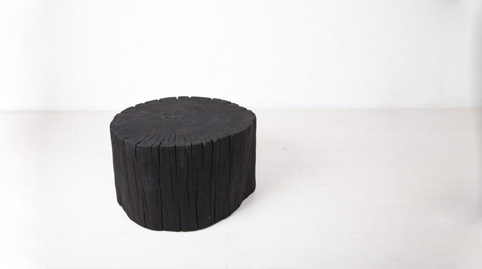 black wooden trunk stool