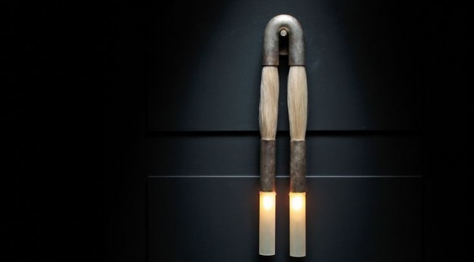 sculptural wall lamp made of metal and hair