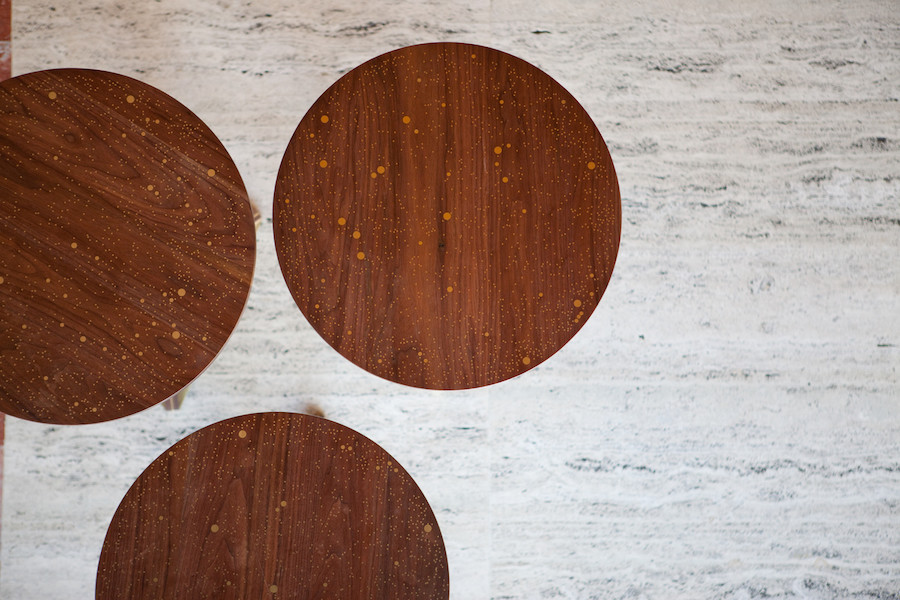 inlaid round wooden table made of brass