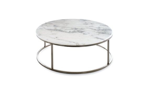 Round coffee table made of marble and steel