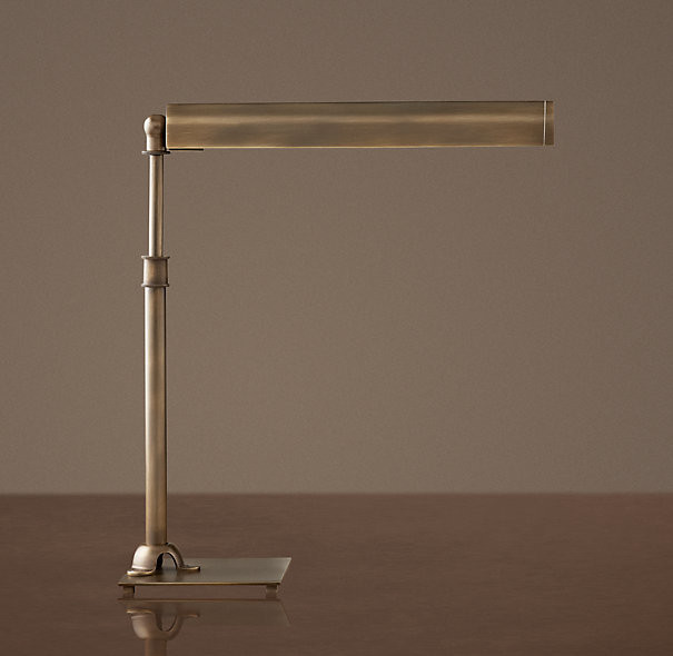 slim table lamp made of bronze