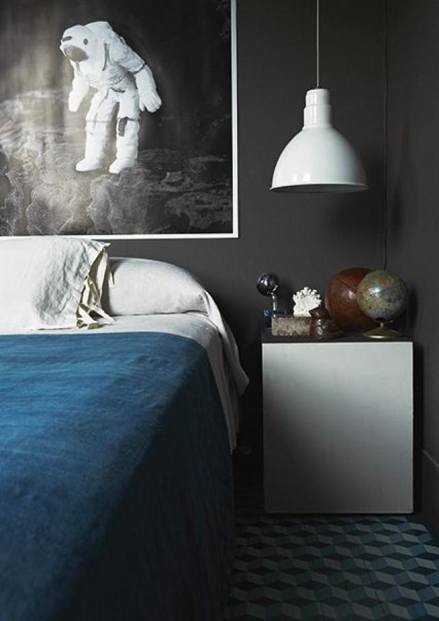 black wall blue bed linen bedroom design