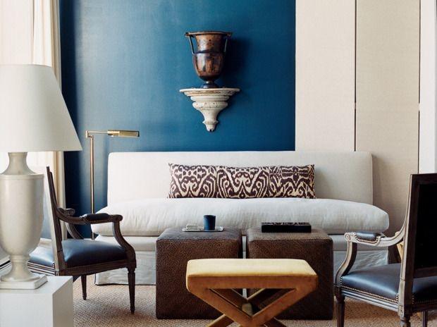 blue accent wall white linen sofa