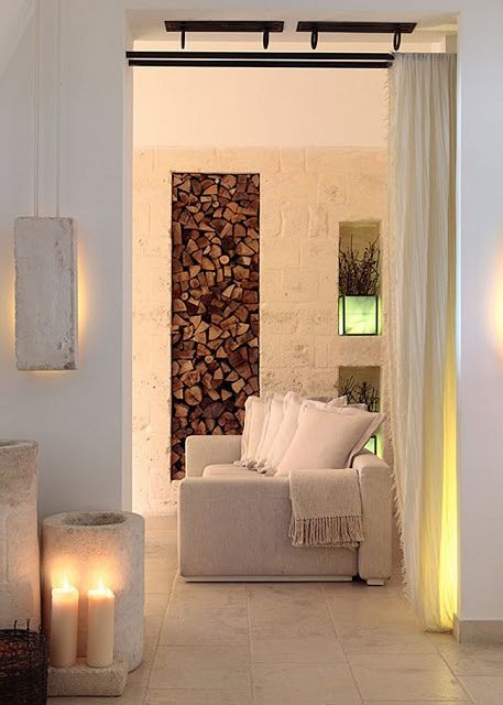 Wood storage in all white living rooms