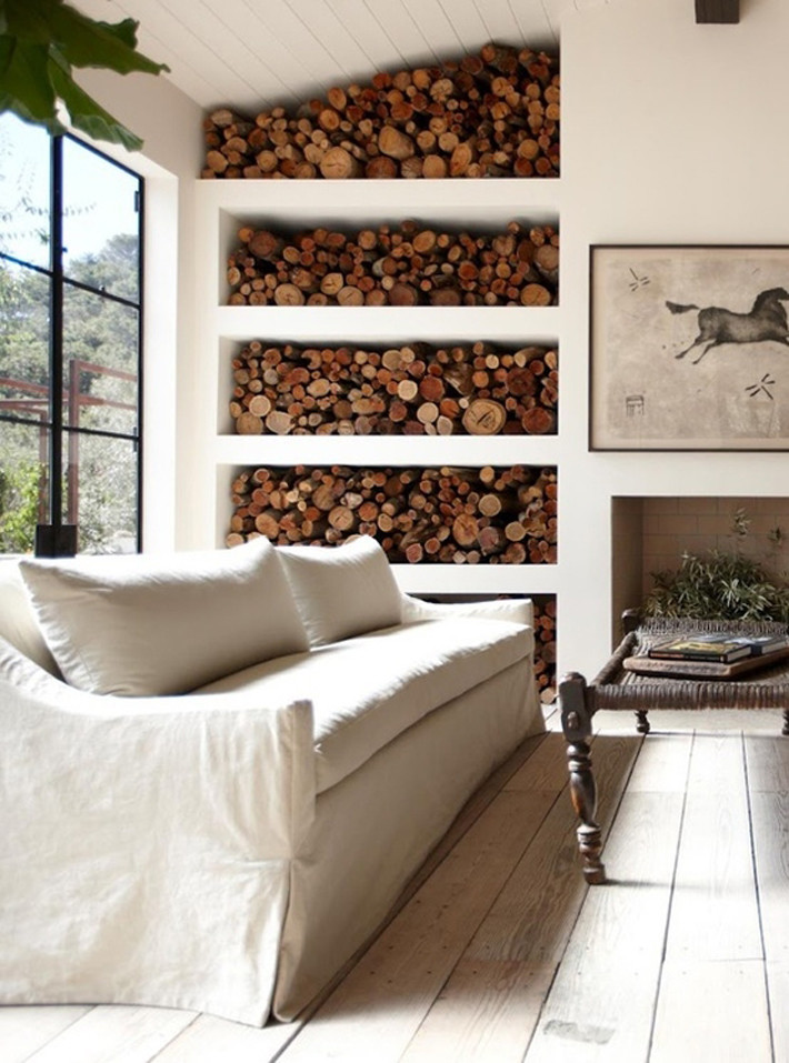 Firewood storage in the living room wall
