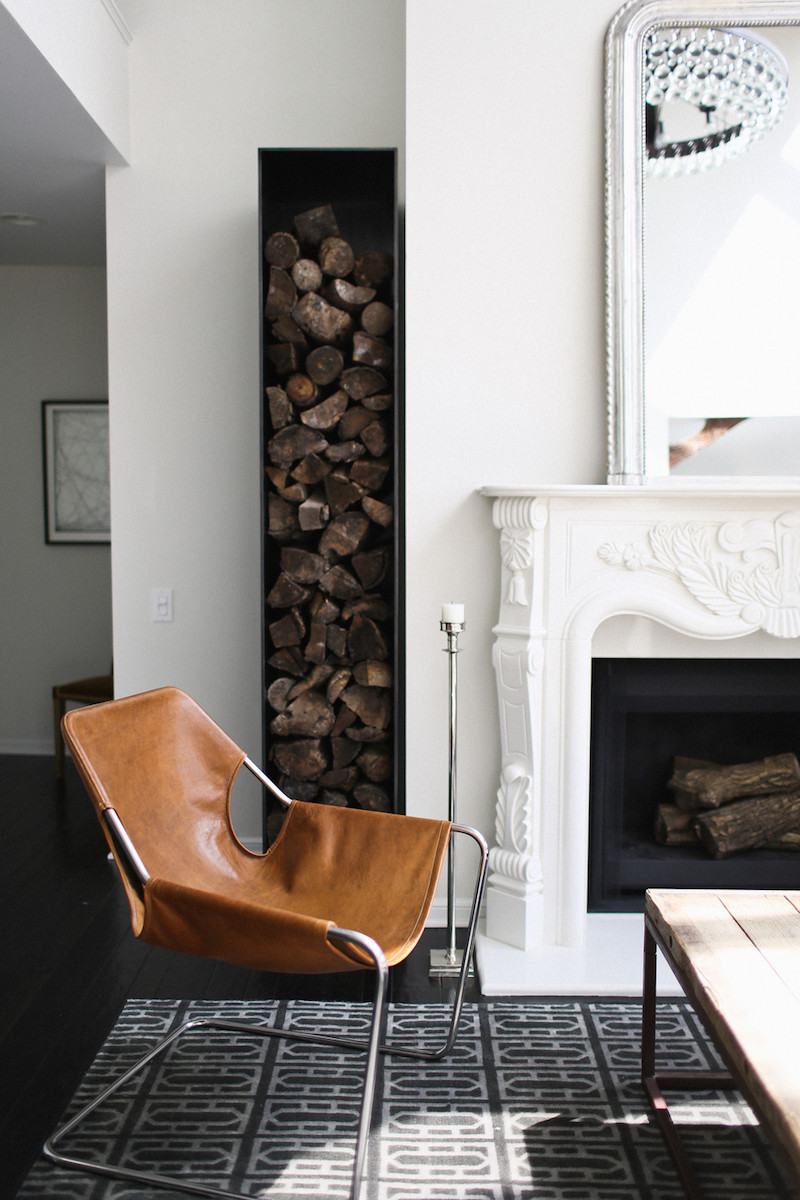 Log storage traditional carved mantelpiece