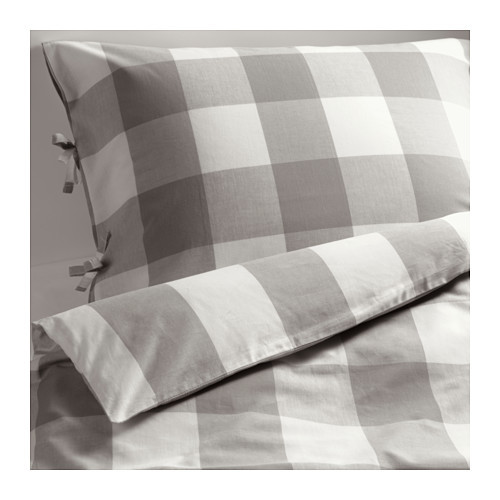 gray bed linen with gingham pattern